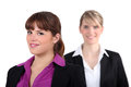 Two female executives executive stood together Stock Images
