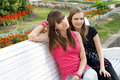 Two female friends on bench Stock Image