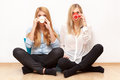 Two female friends having fun drinking coffee and chatting Royalty Free Stock Photography