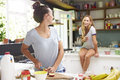 Two Female Friends Preparing Breakfast At Home Together Royalty Free Stock Photo