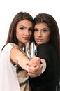 Two female friends in tango pose studio portrait over white background Royalty Free Stock Photos