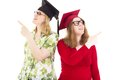Two female graduates happy academic Stock Images