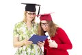 Two female graduates happy academic Stock Photography