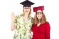 Two female graduates happy academic Stock Photos