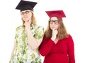 Two female graduates thinking academic Royalty Free Stock Photos
