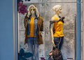 Two female mannequin in warm clothes on shop window