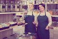 Two female sellers wearing apron Royalty Free Stock Photo