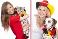 Two female soccer fans with cat and dog isolated Royalty Free Stock Photo