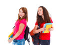Two female students with books and backpacks Stock Photo