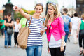 Two female tourists walking along the Charles Bridge while sight Royalty Free Stock Photography