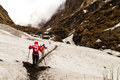 Two females hiking on a snowy trail towards the mountain Royalty Free Stock Photography