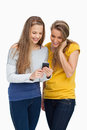 Two females student smiling while looking a cellphone Royalty Free Stock Photo