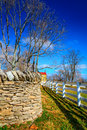 Two fences traditional stone and wooden in shaker village of pleasant hill kentucky Royalty Free Stock Photography