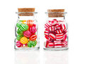 Two filled glass candy jars isolated over white background Royalty Free Stock Image