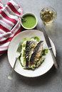 Two fillets of grilled mackerel fish on a plate with mashed potatoes and salsa verde Royalty Free Stock Photo