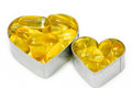 Two Fish Oil pills on Heart Royalty Free Stock Photo