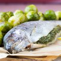 Two fish, rainbow trout stuffed with green herb sauce, Brussels Stock Photos