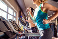 Two fit women running on treadmills in modern gym Royalty Free Stock Photo