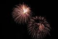 Two flashes of festive white fireworks Stock Image