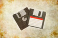 Two floppy disks on grunge background with red and white lable front and Stock Images
