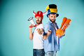 The two football fans with mouthpiece over blue background Royalty Free Stock Photo