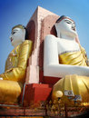 Two of four seated buddha in kyaikpun pagoda the four pago m myanmar blue sky Royalty Free Stock Photo