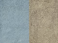 Wall are covered with blue and yellow textured plaster Royalty Free Stock Photo