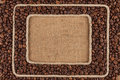 Two frame made of rope with coffee bean on sackcloth Royalty Free Stock Photo