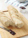 Two fresh bread baguettes with jam Royalty Free Stock Photography