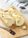 Two fresh bread baguettes with jam Stock Photos