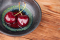 Two fresh cherry sweet in a ceramic bowl Stock Photo