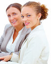 Two friendly female  business colleagues smiling Stock Photos