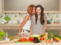 Two friends cooking together Royalty Free Stock Photo
