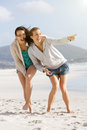 Two friends enjoying life at the beach together portrait of Royalty Free Stock Image