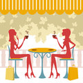 Two friends having coffee or tea and talking Royalty Free Stock Image
