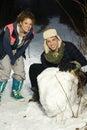 Two friends having fun in snow Stock Photo