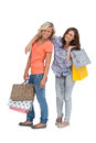 Two friends holding shopping bags on white background Royalty Free Stock Photography