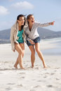 Two friends laughing and enjoying life at the beach portrait of Royalty Free Stock Photo