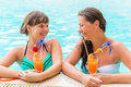 Two friends laughing and joking in the pool Stock Images