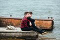 Two friends relaxing on the pier. Royalty Free Stock Photo
