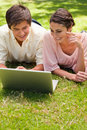 Two friends using a laptop together Royalty Free Stock Image