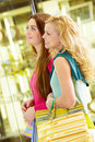 Two friends walking Royalty Free Stock Images