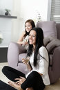 Two friends watching television young at home Royalty Free Stock Image