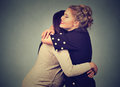 Two friends women hugging Royalty Free Stock Photo