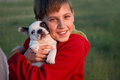 Two friends young boy with his dog Royalty Free Stock Image