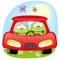 Two frogs in a car is sitting Royalty Free Stock Photo