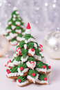 Two frosted gingerbread cookies stacked as christmas trees Stock Photo