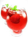 Two fruit red punch drinks with strawberry Royalty Free Stock Photos