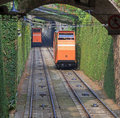 Two funiculars moving on the railroad in bergamo italy Royalty Free Stock Photo