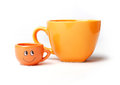 Two funny cups orange big and small Stock Image